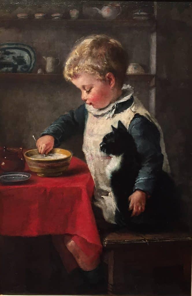 Charlotte Weeks | Jongen met zijn poes aan tafel